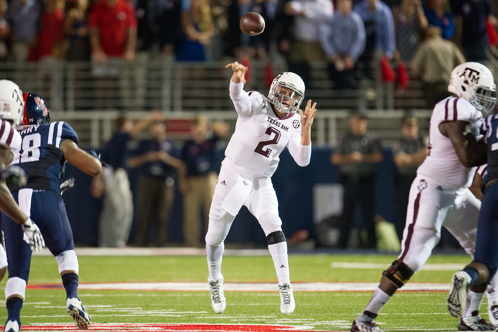 . Quarterback Johnny Manziel #2 of the Texas A&M Aggies throws a pass downfield during their game against the Ole Miss Rebels on October 12, 2013 at Vaught-Hemingway Stadium in Oxford, Mississippi. At halftime Texas A&M leads Ole Miss 14-10.  (Photo by Michael Chang/Getty Images)