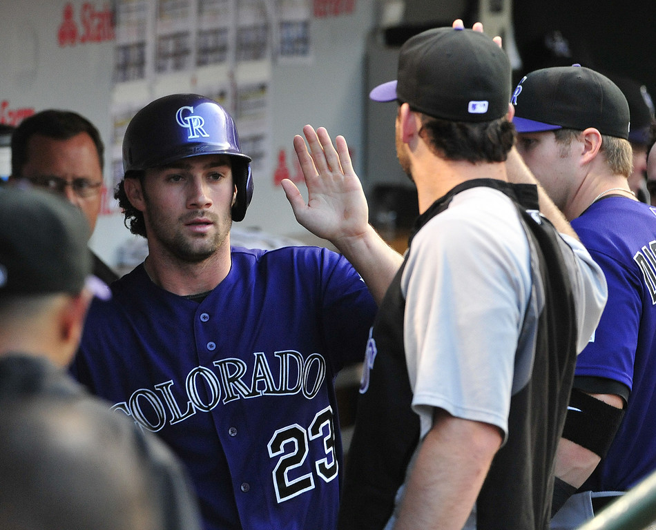 . CHICAGO, IL - JULY 30:  Charlie Culberson #23 of the Colorado Rockies is greeted in the dugout after scoring against the Chicago Cubs during the second inning on July 30, 2014 at Wrigley Field in Chicago, Illinois. (Photo by David Banks/Getty Images)