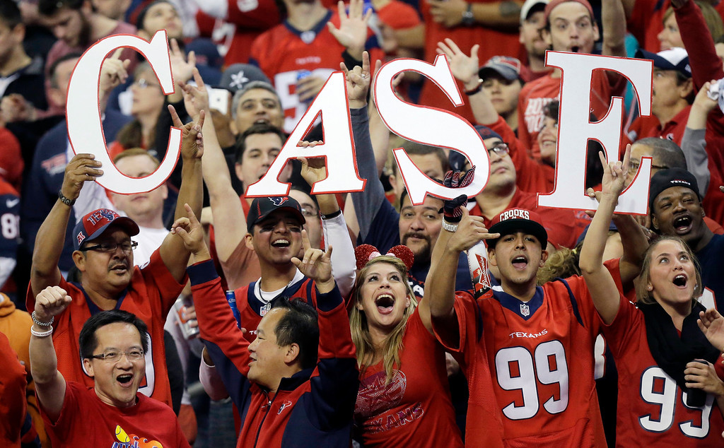 . Fans cheer for Houston Texans\' Case Keenum during the first quarter of an NFL football game against the Indianapolis Colts, Sunday, Nov. 3, 2013, in Houston. (AP Photo/Patric Schneider)