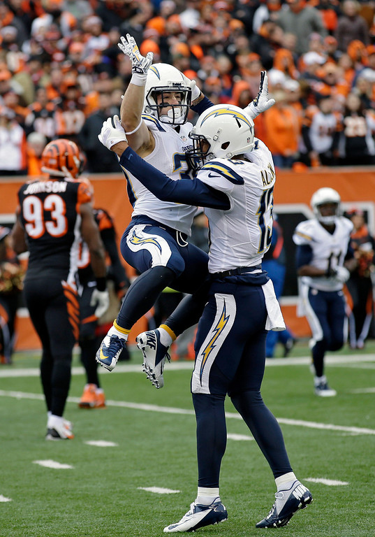 . San Diego Chargers running back Danny Woodhead, left, celebrates his touchdown with wide receiver Keenan Allen in the first half of an NFL wild-card playoff football game against the Cincinnati Bengals, Sunday, Jan. 5, 2014, in Cincinnati. (AP Photo/Al Behrman)