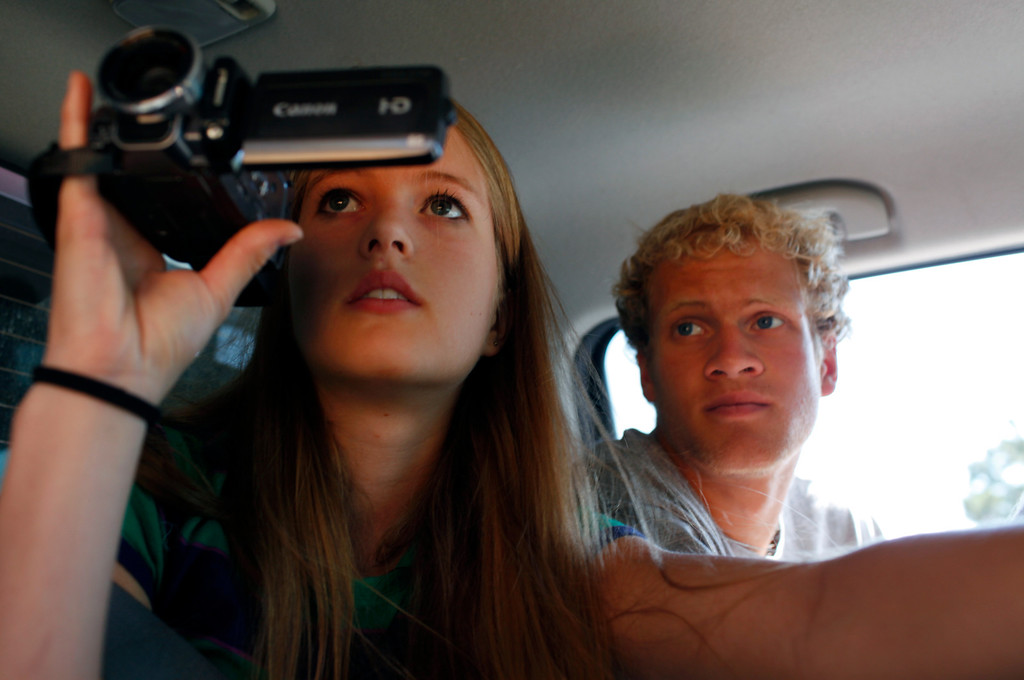 . Krista Albers, 19, and her brother Eric Albers, 17, look out the window of their truck to see their property in the Mountain Shadows subdivision on Sunday, July 1, 2012. Their home was one of the more than 350 homes burned in the Waldo Canyon fire. Stephen Mitchell, The Denver Post