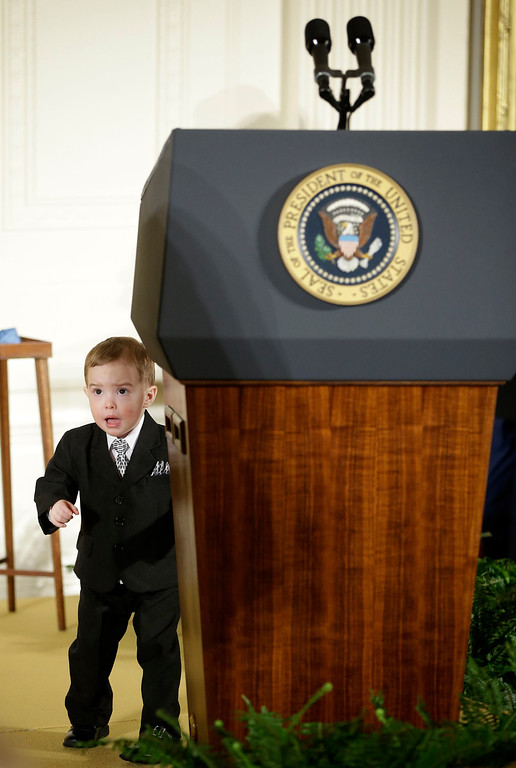 . Colin Romesha, son of Medal of Honor recipient retired Staff Sgt. Clinton Romesha, plays behind the Presidential podium in the East Room of the White House in Washington, Monday, Feb. 11, 2013, prior to the start of the medal of honor ceremony.(AP Photo/Pablo Martinez Monsivais)