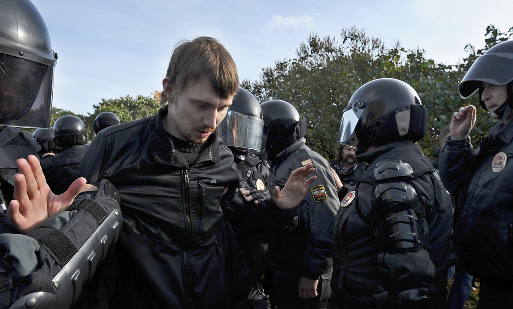 . Russian OMON, riot police, officers detain a gay rights activist (L) during a gay pride event in Saint Petersburg on October 12, 2013. Russian police arrested today in the city of Saint Petersburg several people after clashes erupted between pro- and anti-gay demonstrators. OLGA MALTSEVA/AFP/Getty Images