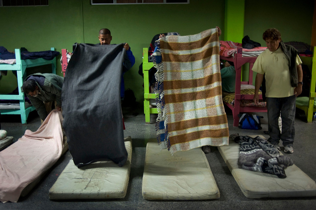 . Men prepare bedding at the La Roca del Alfarero, a Christian-run homeless shelter, in Tijuana, Mexico, 07 May 2013. The vast majority of the men who stay at the shelter are homeless deportees. Heightened US border security and record numbers of deportations from the US have created a growing population of people who live homeless in Mexican cities that border with the United States. Many had lived for years undocumented in the US and have little or no family and other support in Mexico, and are subject to fall into depression, substance abuse and crime. Tijuana, Mexico, borders on the US city of San Diego, California.  EPA/DAVID MAUNG