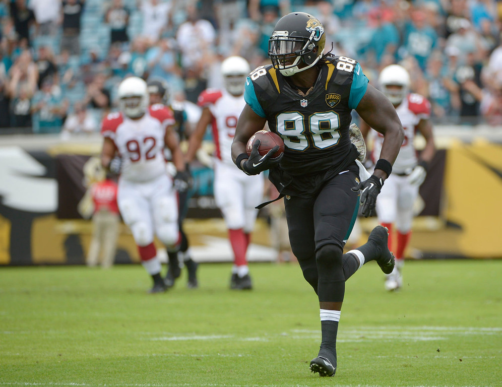 . Jacksonville Jaguars tight end Danny Noble (88) outruns the Arizona Cardinals defense to the end zone on a 62-yard touchdown pass during the first half of an NFL football game in Jacksonville, Fla., Sunday, Nov. 17, 2013. (AP Photo/Phelan M. Ebenhack)