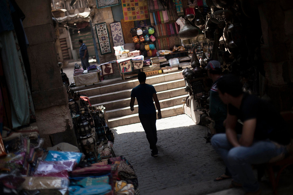. An Egyptian man walks through an empty alley in the Khan El-Khalili market, normally a popular tourist destination, in Cairo, Egypt, Wednesday, Aug. 21, 2013. Riots and killings that erupted across the country after the crackdown against followers of ousted President Mohammed Morsi have delivered a severe blow to Egypt\'s tourism industry, which until recently accounted for more than 11 percent of the country\'s gross domestic product and nearly 20 percent of its foreign currency revenues. (AP Photo/Manu Brabo)