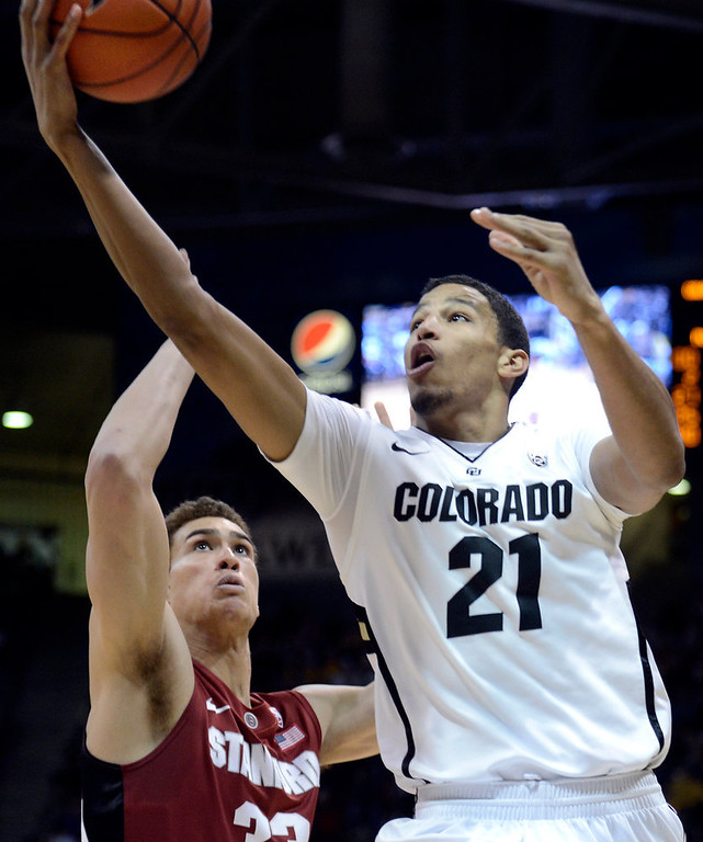 . University of Colorado\'s Andre Roberson goes for a layup over Dwight Powell during a game against Stanford on Thursday, Jan. 24, at the Coors Event Center on the CU campus in Boulder. Jeremy Papasso/ Camera