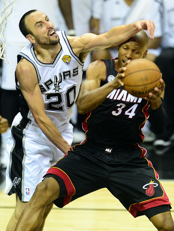 . Manu Ginobili of the San Antonio Spurs vies for the ball with Ray Allen of the Miami Heat during game 5 of the NBA finals on June 16, 2013 in San Antonio, Texas., where the Spurs defeated the Heat 114-104 and now lead the series 3-2.    FREDERIC J. BROWN/AFP/Getty Images