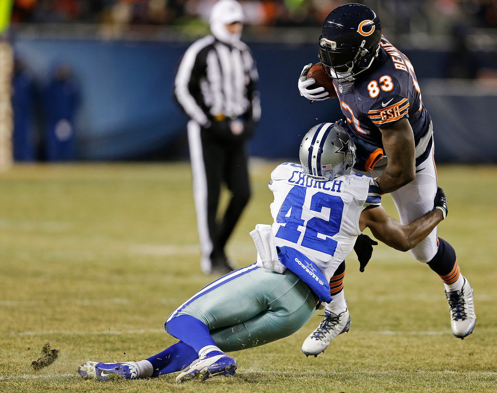 . Dallas Cowboys safety Barry Church (42) tackles Chicago Bears tight end Martellus Bennett (83) during the first half of an NFL football game, Monday, Dec. 9, 2013, in Chicago. (AP Photo/Nam Y. Huh)