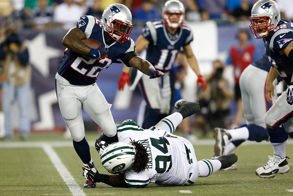 . Running back Stevan Ridley #22 of the New England Patriots runs the ball against nose tackle Damon Harrison #94 of the New York Jets in the second quarter at Gillette Stadium on September 12, 2013 in Foxboro, Massachusetts.  (Photo by Jim Rogash/Getty Images)