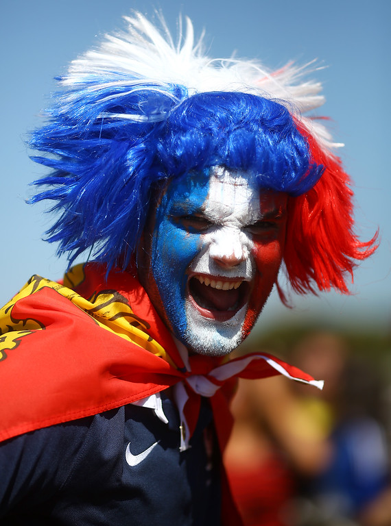 . A France fan enjoys the atmosphere prior to the 2014 FIFA World Cup Brazil Round of 16 match between France and Nigeria at Estadio Nacional on June 30, 2014 in Brasilia, Brazil.  (Photo by Celso Sarmento/Getty Images)