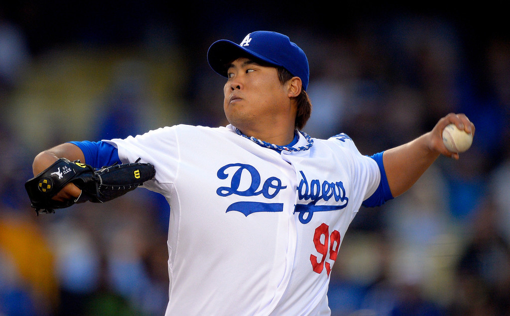 . Los Angeles Dodgers starting pitcher Ryu Hyun-jin, of South Korea, throws to the plate during the first inning of their baseball game against the Colorado Rockies, Tuesday, April 30, 2013, in Los Angeles. (AP Photo/Mark J. Terrill)