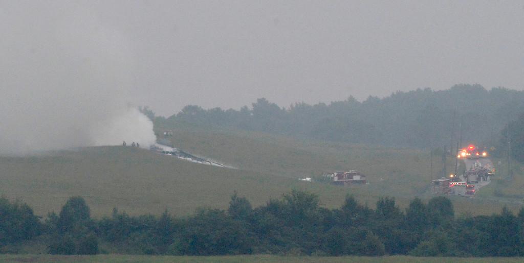 . A UPS cargo plane lies on a hill at Birmingham-Shuttlesworth International Airport after crashing on approach, Wednesday, Aug. 14,  2013, in Birmingham, Ala.  (AP Photo/ AL.com, Mark Almond)