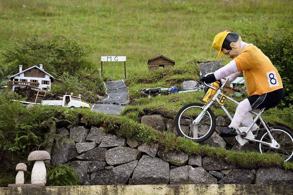 . A model representing a cyclist wearing the overall leader\'s yellow jersey and climbing a hill, is pictured at the departure village in Gerardmer before the start of the 170 km ninth stage of the 101st edition of the Tour de France cycling race on July 13, 2014 between Gerardmer and Mulhouse, eastern France.  LIONEL BONAVENTURE/AFP/Getty Images