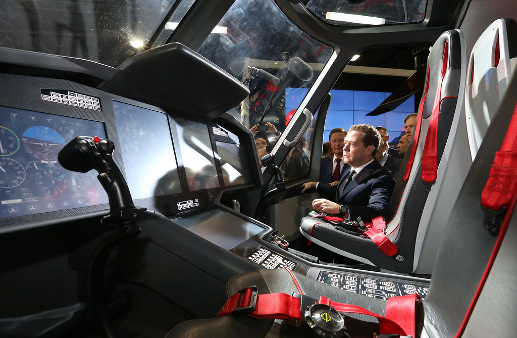 . Russia\'s Prime Minister Dmitry Medvedev (R) listens to explanations as he visits the pavilion of the United Industrial Corporation Obornprom at the MAKS International Aviation and Space Salon in Zhukovsky outside Moscow on August 27, 2013. AFP PHOTO / RIA NOVOSTI / POOL / EKATERINA  SHTUKINA/AFP/Getty Images