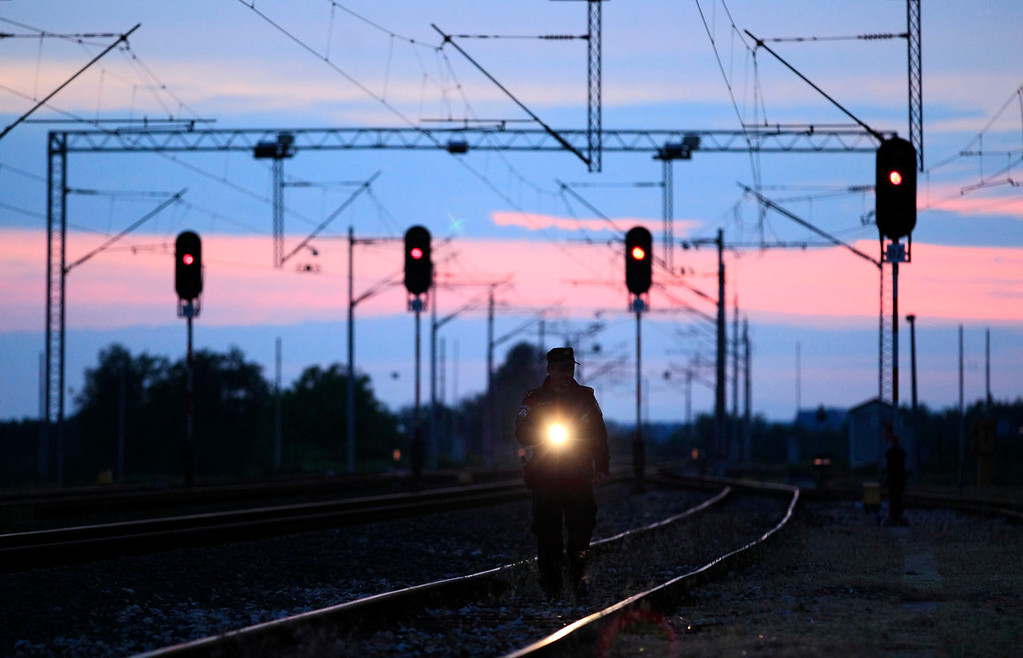 . A Croatian border police officer inspects the railway near the Croatia-Serbia border in Tovarnik, east Croatia, May 12, 2013. Croatia became the European Union\'s 28th member on July 1 and its roughly 1,400 km of land border with non-EU neighbors Bosnia, Serbia and Montenegro will now become the bloc\'s new external frontier. Croatia lies on the notorious Balkan smuggling route, used for transporting illegal migrants and drugs from the Middle East and Africa into western Europe, and its border police have modernized their equipment to include thermal vision cameras and infrared binoculars to improve control. Picture taken May 12, 2013. REUTERS/Antonio Bronic