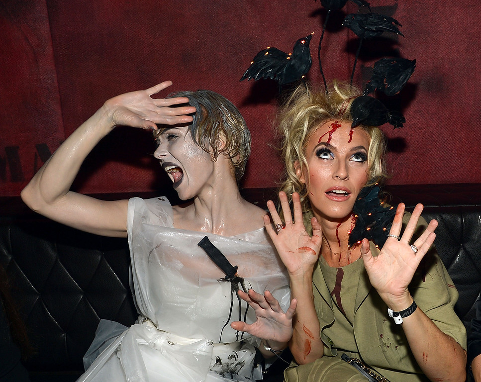 . Designers Georgina Chapman (L) and Keren Craig attend Shutterfly Presents Heidi Klum\'s 14th Annual Halloween Party sponsored by SVEDKA Vodka and smartwater at Marquee on October 31, 2013 in New York City.  (Photo by Mike Coppola/Getty Images for Heidi Klum)