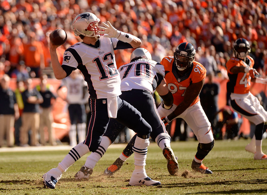 . New England Patriots quarterback Tom Brady (12) drops back to throw during the first quarter. The Denver Broncos vs. The New England Patriots in an AFC Championship game  at Sports Authority Field at Mile High in Denver on January 19, 2014. (Photo by John Leyba/The Denver Post)