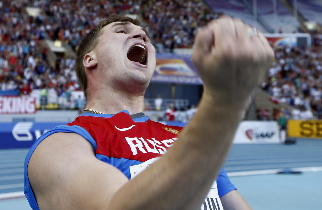 . Russia\'s Dmitri Tarabin celebrates bronze after the men\'s javelin throw final at the 2013 IAAF World Championships at the Luzhniki stadium in Moscow on August 17, 2013.  FRANCK FIFE/AFP/Getty Images
