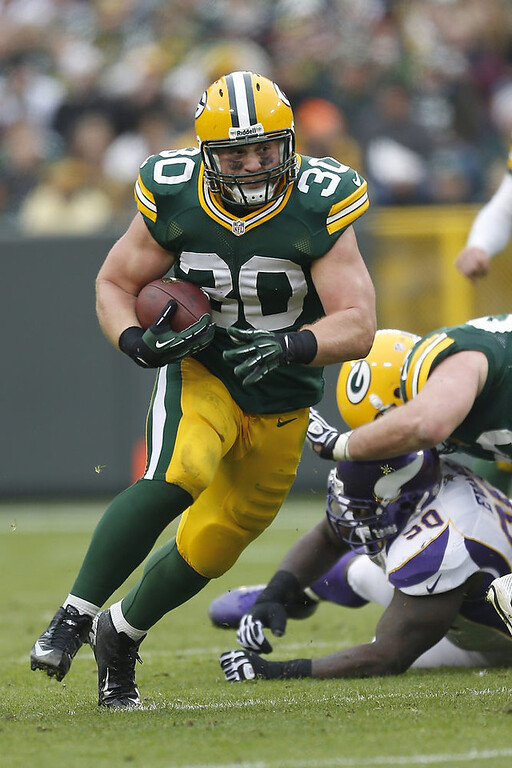 . John Kuhn #30 of the Green Bay Packers runs the ball against the Minnesota Vikings at Lambeau Field on December 2, 2012 in Green Bay, Wisconsin.  The Packers defeated the Vikings 23-14.  (Photo by Wesley Hitt/Getty Images)