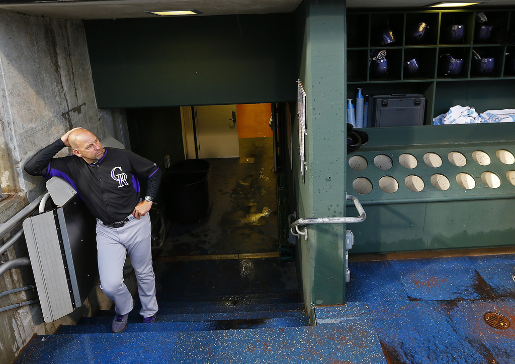 . Manager Walt Weiss #22 of the Colorado Rockies looks onto the field during a rain delay before the start of their game against the Philadelphia Phillies at Citizens Bank Park on May 27, 2014 in Philadelphia, Pennsylvania. (Photo by Rich Schultz/Getty Images)
