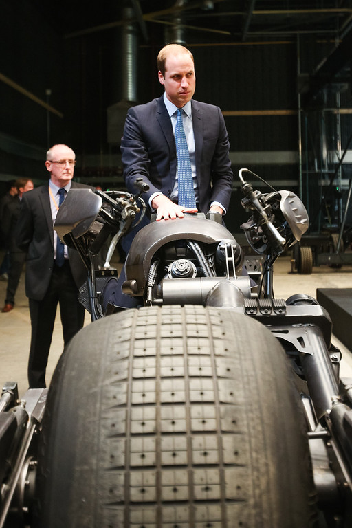 . Prince William, Duke of Cambridge site the \'Batpod\', which was used in the Batman films as he attends the Inauguration Of Warner Bros. Studios Leavesden on April 26, 2013 in London, England.  (Photo by Paul Rogers - WPA Pool/Getty Images)