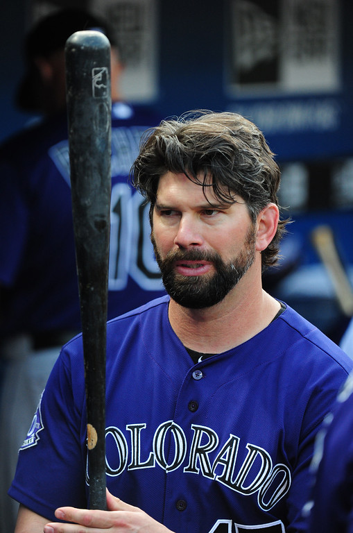 . Todd Helton #17 of the Colorado Rockies grabs a bat to hit against the Atlanta Braves at Turner Field on July 31, 2013 in Atlanta, Georgia. (Photo by Scott Cunningham/Getty Images)