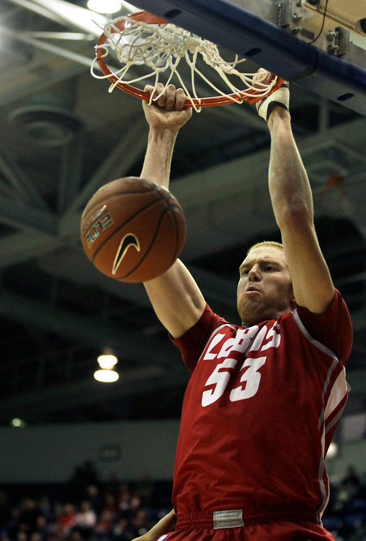 . New Mexico\'s Alex Kirk scores during the first half of an NCAA college basketball game against Air Force in Air Force Academy, Colo., Saturday, March 9, 2013. (AP Photo/Brennan Linsley)