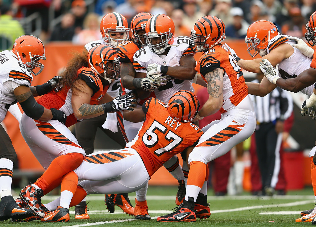 . Chris Ogbonnaya #25 of the Cleveland Browns is tackled by the Cincinnati Bengals defense during the NFL game at Paul Brown Stadium on November 17, 2013 in Cincinnati, Ohio.  (Photo by Andy Lyons/Getty Images)