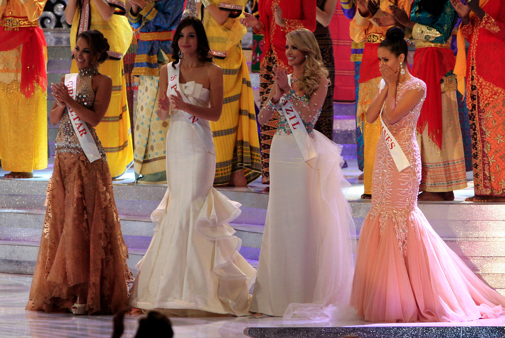 . Miss Philippine Megan Young, right, reacts after winning the Miss World pageant final in Nusa Dua, Bali, Indonesia, Saturday, Sept. 28, 2013. (AP Photo/Firdia Lisnawati)