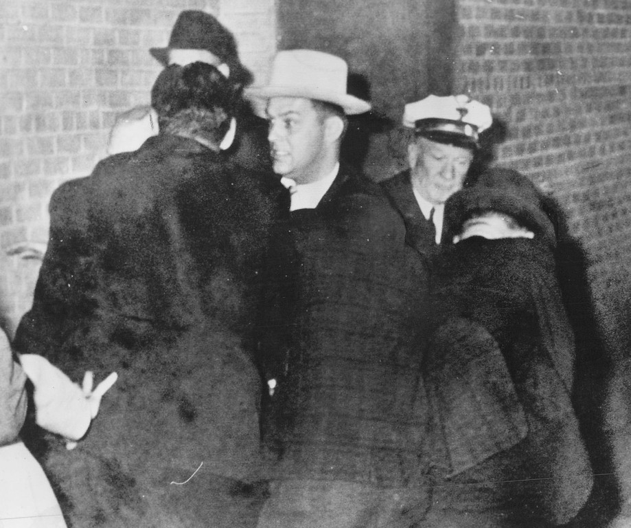 . Detectives of the Dallas Police Department struggle with  nightclub owner Jack Ruby after he shot Oswald in the basement of the Dallas city jail Nov. 24, 1963. Associated Press file