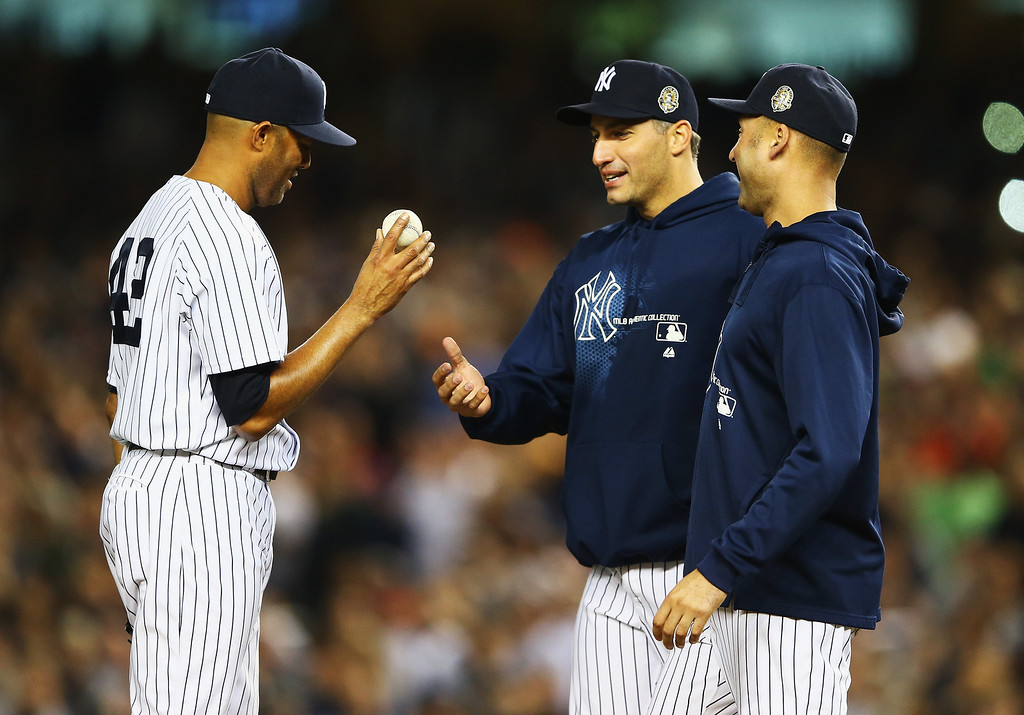 . NEW YORK, NY - SEPTEMBER 26:  Mariano Rivera #42 of the New York Yankees is taken out of the game by Derek Jeter #2, and Andy Pettitte #46 in the ninth inning against the Tampa Bay Rays during their game on September 26, 2013 at Yankee Stadium in the Bronx borough of New York City.  (Photo by Al Bello/Getty Images)
