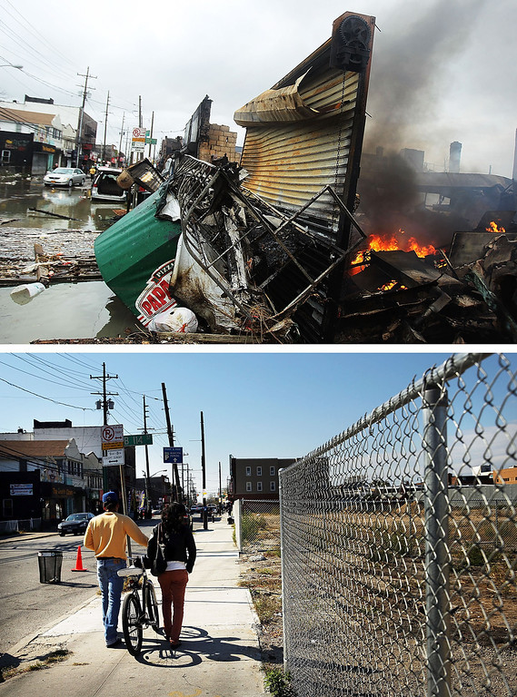 . NEW YORK, NY - OCTOBER 30: (top) A fire burns near destroyed homes and businesses following Hurricane Sandy on October 30, 2012 in the Rockaway section of the Queens borough of New York City. NEW YORK, NY - OCTOBER 23: (bottom) Two people walk down a sidewalk past a now empty lot on October 23, 2013 in the Rockaway section of the Queens borough of New York City.  Hurricane Sandy made landfall on October 29, 2012 near Brigantine, New Jersey and affected 24 states from Florida to Maine and cost the country an estimated $65 billion.  (Photos by Spencer Platt/Getty Images)