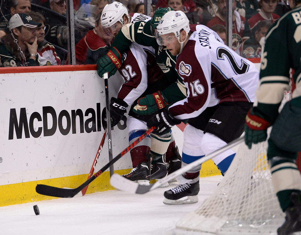 . Colorado Avalanche center Paul Stastny (26) chase the puck down behind the Minnesota Wild goal during the second period  April 28, 2014 in Game 6 of the Stanley Cup Playoffs at Xcel Energy Center.  (Photo by John Leyba/The Denver Post)