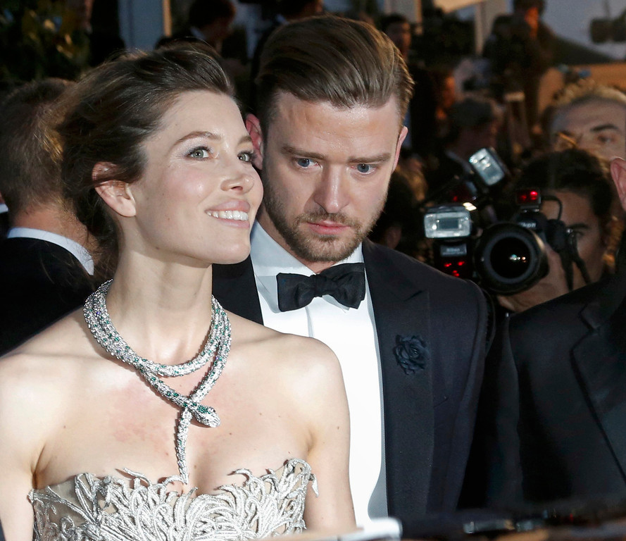 ". Actor and singer Justin Timberlake (R) and actress Jessica Biel leave after the screening of the film ""Inside Llewyn Davis\"" in competition during the 66th Cannes Film Festival in Cannes May 19, 2013.           REUTERS/Jean-Paul Pelissier"