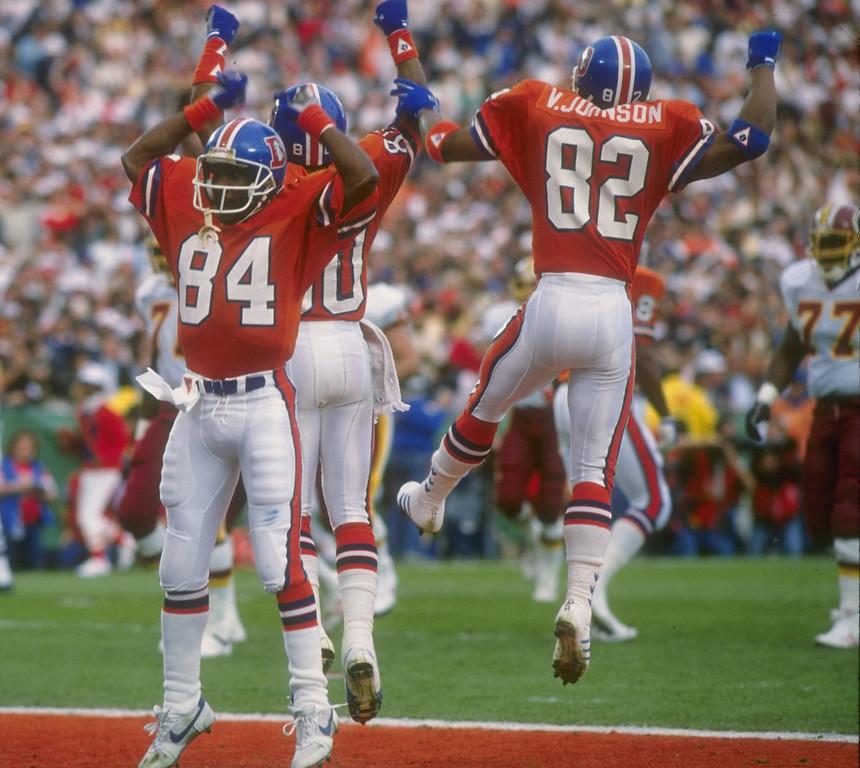 . Denver Broncos wide receivers Ricky Nattiel, Mark Jackson, and Vance Johnson (l to r) celebrate during Super Bowl XXII against the Washington Redskins at Jack Murphy Stadium in San Diego, California.  The Redskins won the game, 42-10. Rick Stewart/Allsport