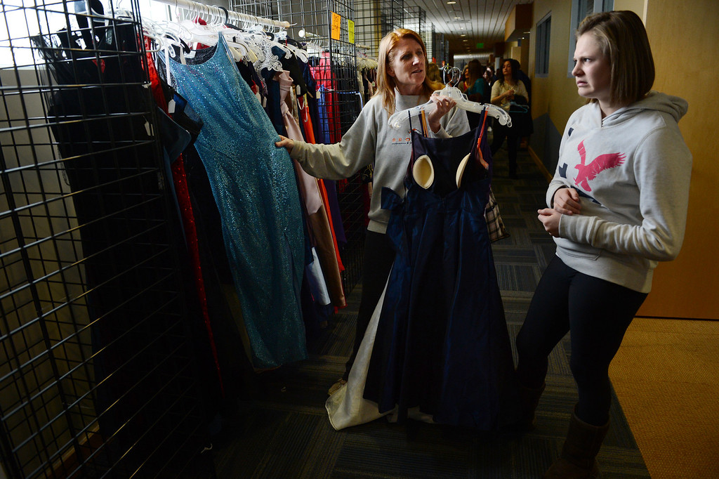 ". COMMERCE CITY, CO. - MARCH 16: Jordan Beeson, a freshman at Faith Christian Academy, reacts to a dress while shopping with her mother, Lisa, at the Prom Dress Exchange Corp. event in Commerce City, CO March 16, 2013. With a valid student ID and a suggested $10 donation, teenage girls could chose from 1,356 donated dresses that lined a long hallway at Dick�s Sporting Goods Park. Lisa said, ""I think it\'s amazing... to have an opportunity to not break the bank for a one night event. That\'s awesome.\""(Photo By Craig F. Walker/The Denver Post)"