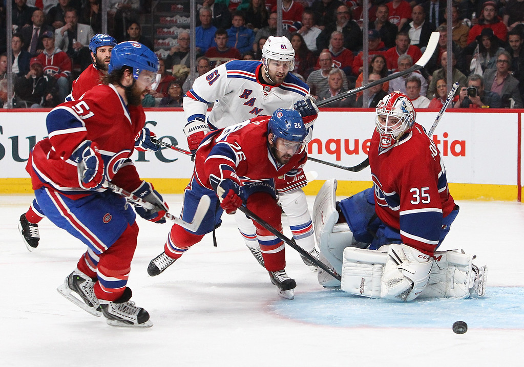 . Dustin Tokarski #35 of the Montreal Canadiens defends the net against Rick Nash #61 of the New York Rangers during Game Five of the Eastern Conference Final in the 2014 NHL Stanley Cup Playoffs at Bell Centre on May 27, 2014 in Montreal, Canada.  (Photo by Francois Laplante/FreestylePhoto/Getty Images)
