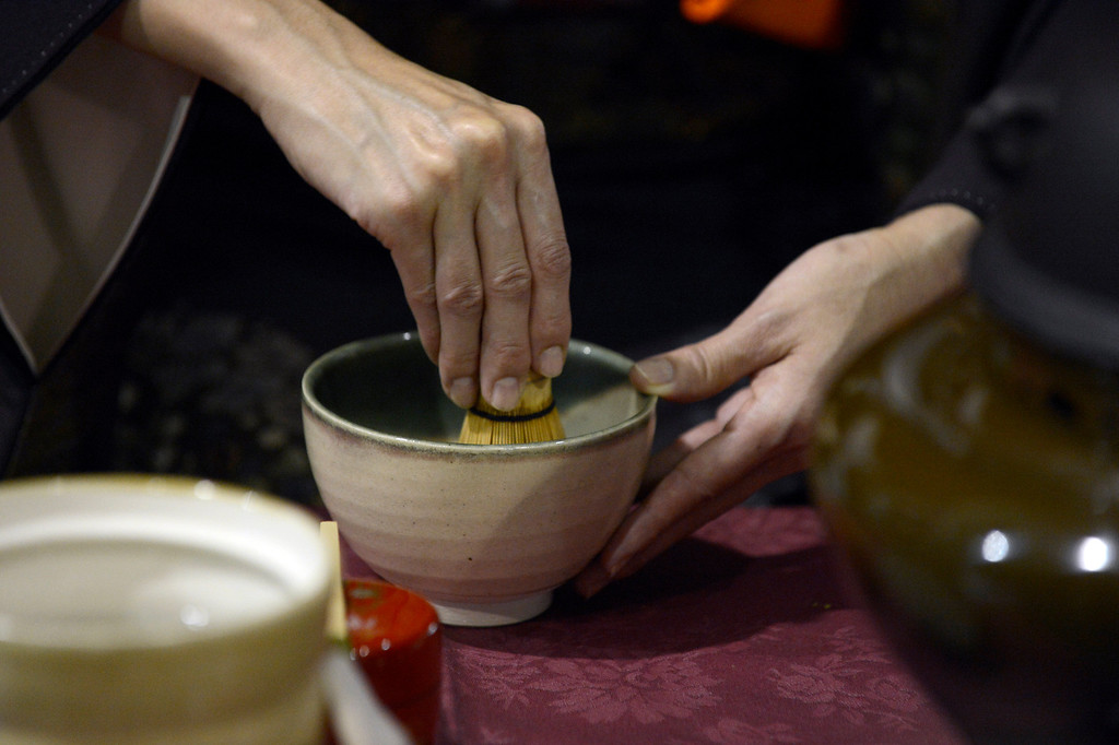 . DENVER, CO. - JANUARY 27: Kyoko Nakagawa makes tea during a traditional Japanese tea ceremony at the World Tea Fair held at Denver Montclair International School January 27, 2013.  There were 12 tables featuring tea samples from around the World.Photo By John Leyba / The Denver Post)