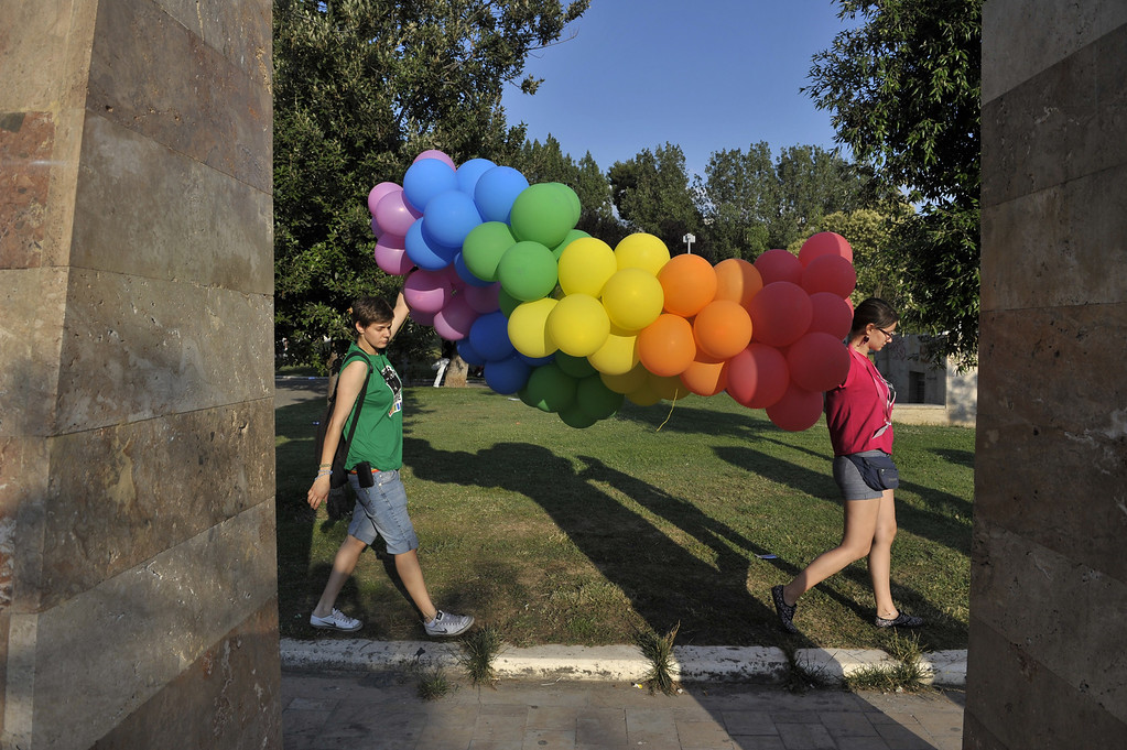 . Participants of the second gay pride hold rainbow balloons as they march through the city of Thessaloniki on June 15, 2013. Thousands of people took part in a march organized by Greece\'s gay and lesbian community in the northern Greek city of Thessaloniki. AFP PHOTO /Sakis  MITROLIDIS/AFP/Getty Images