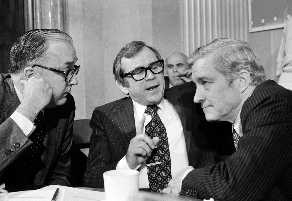 . FILE - This Nov. 9, 1979 file photo shows three members of the Senate Foreign Relations Committee, from left, Sen. Jesse Helms, R-N.C., Sen. Howard Baker, R-Tenn., and Sen. Charles Percy, R-Ill discussing the vote in favor of the SALT II treaty, on Capitol Hill in Washington. Baker, who asked what President Richard Nixon knew about Watergate, has died. He was 88. Baker, a Republican, served 18 years in the Senate. He earned the respect of Republicans and Democrats alike and rose to the post of majority leader. He served as White House chief of staff at the end of the Reagan administration and was U.S. ambassador to Japan during President George W. Bush\'s first term. (AP Photo/Charles W. Harrity, File)