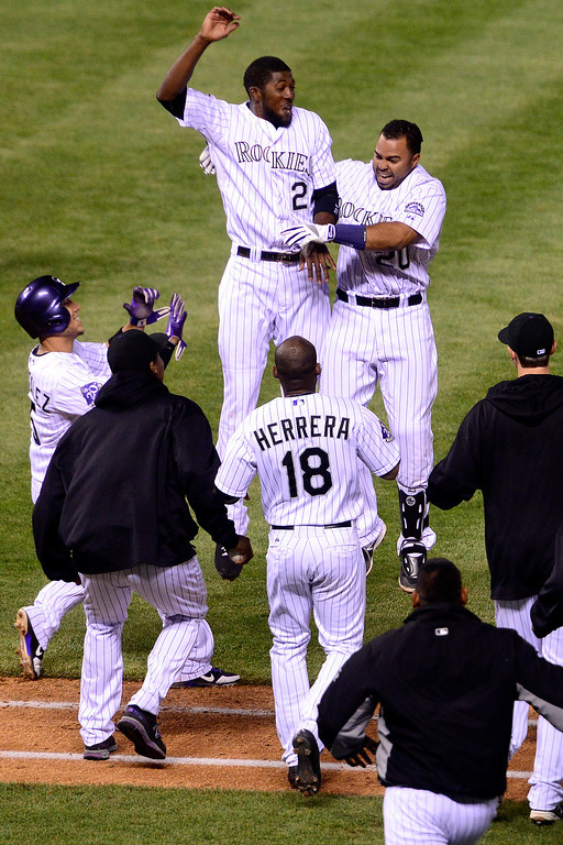 . DENVER, CO - MAY 21: Wilin Rosario (20) of the Colorado Rockies celebrates his game-winning hit with Dexter Fowler (24) during the Rockies\' 5-4 win at Coors Field. The Arizona Diamondbacks visited the Colorado Rockies. (Photo by AAron Ontiveroz/The Denver Post)