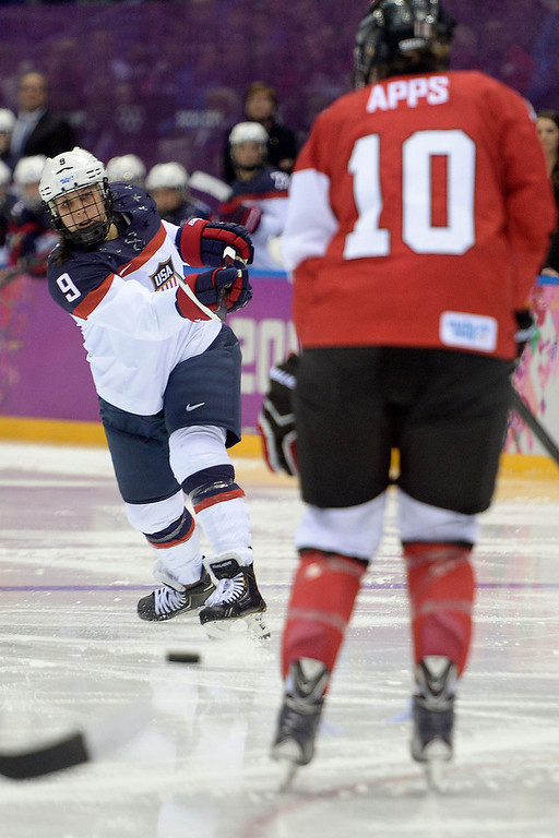 . Megan Bozek (9) of the U.S.A. takes a shot as Gillian Apps (10) of the Canada defends during the third period of the women\'s gold medal ice hockey game. Sochi 2014 Winter Olympics on Thursday, February 20, 2014 at Bolshoy Ice Arena. (Photo by AAron Ontiveroz/ The Denver Post)