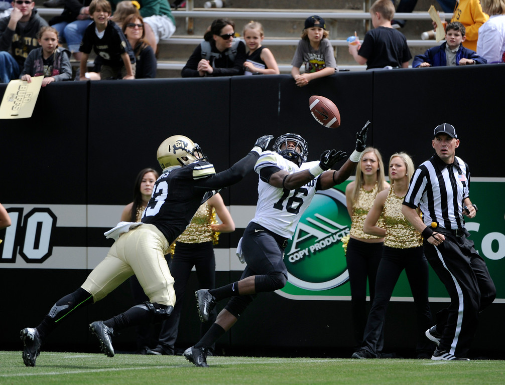 . BOULDER, CO.- APRIL13: Fans watch as Jeffrey Hall, right, tries to catch a TD pass with Parker Orms on his tail. Hall was unable to come up with the ball in the end zone. The University of Colorado football team hosts its spring football game at Folsom Field under the direction of new head coach Mike MacIntyre. (Photo By Kathryn Scott Osler/The Denver Post)