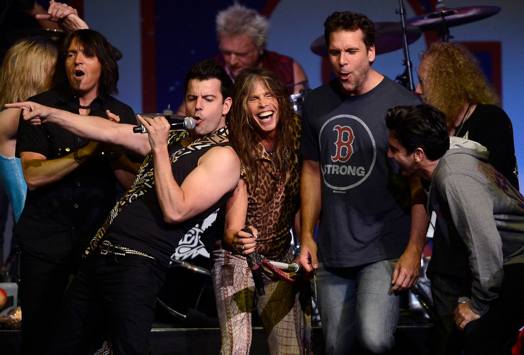 . Performers, including Jordan Knight of New Kids on the Block (2nd L), Steven Tyler of Aerosmith (C) and comedian Dane Cook (3rd R), sing at the finale of the Boston Strong benefit concert at the Boston TD Garden, May 30, 2013.  REUTERS/Gretchen Ertl
