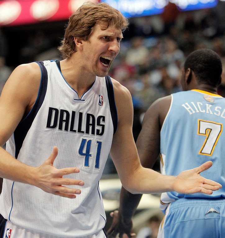 . Dallas Mavericks forward Dirk Nowitzki reacts to a call during the first half of an NBA basketball game against the Denver Nuggets on Monday, Nov. 25, 2013, in Dallas. (AP Photo/Brandon Wade)