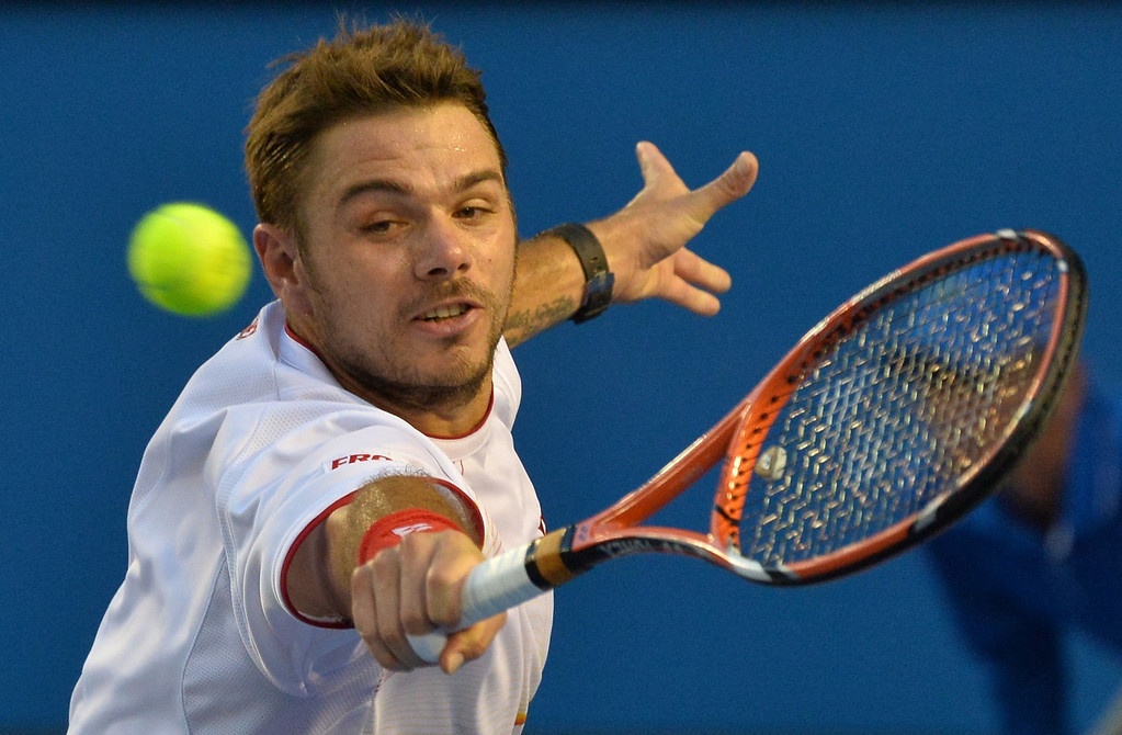 . Stanislas Wawrinka of Switzerland hits a return against Rafael Nadal of Spain in the men\'s singles final on day 14 of the 2014 Australian Open tennis tournament in Melbourne on January 26, 2014.     PAUL CROCK/AFP/Getty Images