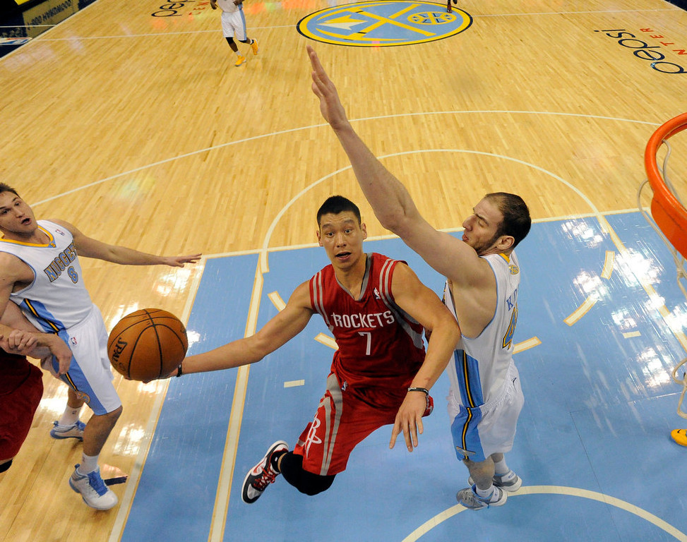 . DENVER, CO. - JANUARY 30: Houston Rockets point guard Jeremy Lin (7) drives to the basket on Denver Nuggets center Kosta Koufos (41) during the fourth quarter January 30, 2013 at Pepsi Center.  The Denver Nuggets take on the Houston Rockets in NBA action. (Photo By John Leyba/The Denver Post)