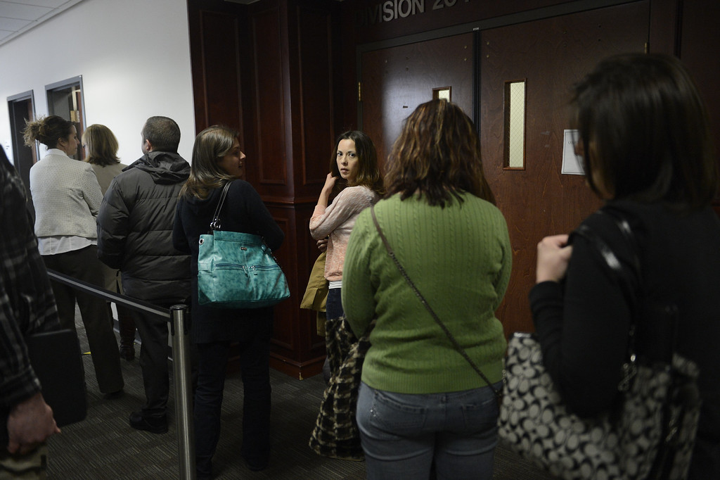 . CENTENNIAL, CO. - APRIL 10: Victims and family waiting to go into the hearing for Fox News reporter Jana Winter for protecting her sources in a story connected to mass murderer James Holmes at the Arapahoe County Justice Center April 10, 2013 Centennial, Colorado. (Photo By Joe Amon/The Denver Post)