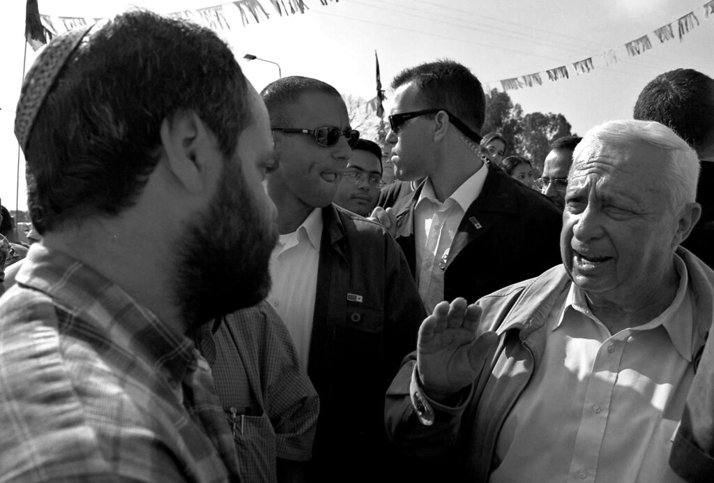 . Israeli Prime Minister Ariel Sharon speaks to Jewish settlers May 4, 2001 at their settlement of Netzer Hazani in the Gaza Strip. Twenty-eight years after its establishment in 1977, the descendants of Netzer Hazani\'s founding settlers and the others that followed them are threatening a last stand against forced removal as Israeli Prime Minister Ariel Sharon\'s disengagement plan approaches its August 15, 2005 implementation. (Photo by Amor Ben Gershom/GPO via Getty Images)